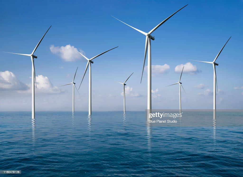Wind turbine farm in beautiful nature landscape. : Stock Photo