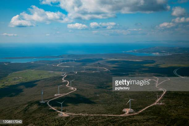 wind turbine farm - carbon footprint stock pictures, royalty-free photos & images