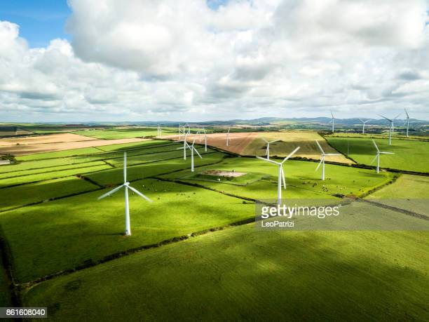 wind turbine fields in cornwall - windmills stock photos and pictures