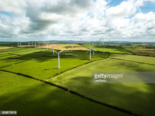 wind turbine fields in uk - windmills stock photos and pictures
