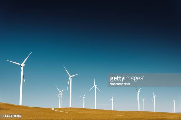 wind turbine in montana - sustainable energy stock pictures, royalty-free photos & images