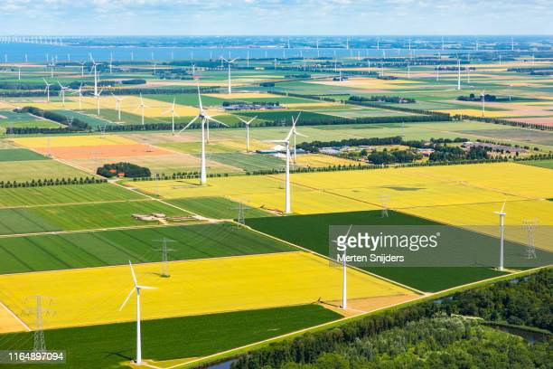 wind turbine installations at flevoland farm fields - merten snijders stock pictures, royalty-free photos & images