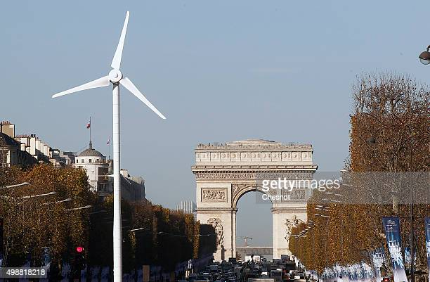 A wind turbine is installed to provide electricity for Christmas illuminations on the ChampsElysee on November 26 2015 in Paris France This event...