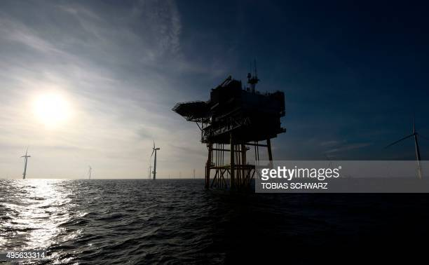 A wind turbine is pictured next to an electrical offshore substation at the German offshore wind farm 'Amrum Bank West' owned by German energy...