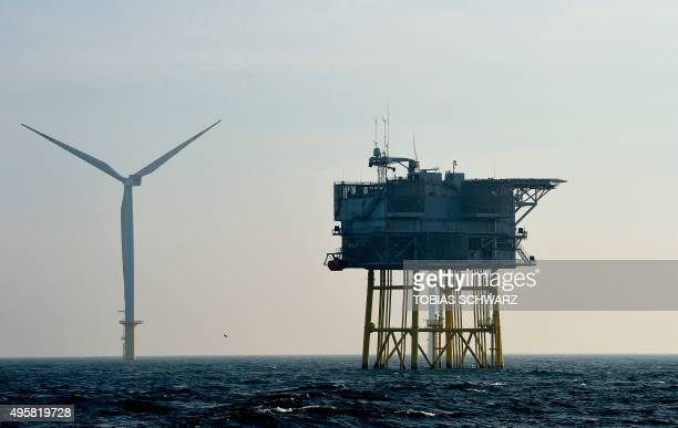A wind turbine is pictured next to an electrical offshore substation operated by Germany's biggest power supplier Eon at the offshore wind farm...