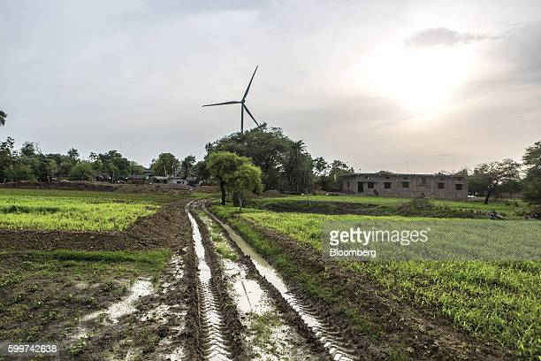 A wind turbine manufactured by Gamesa Corp stands near a farm in Dewas Madhya Pradesh India on Tuesday July 5 2016 Farmers in Dewas district where...