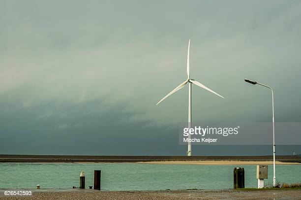 Wind turbine on dyke, Vrouwenpolder, Zeeland, The Netherlands