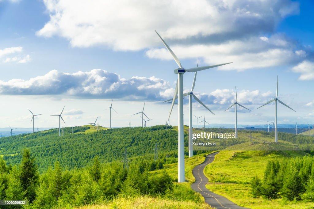 Wind turbine on field in hill : ストックフォト