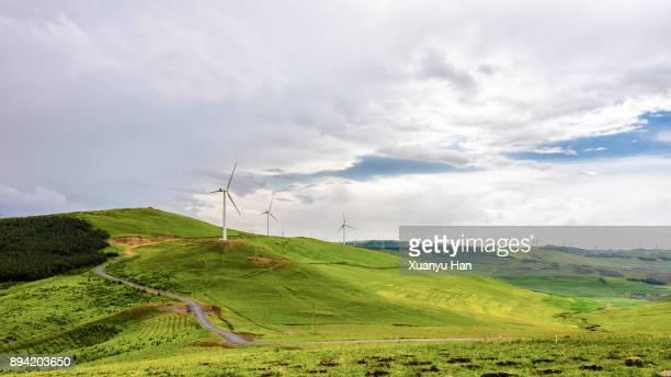 Wind turbine on field in hill