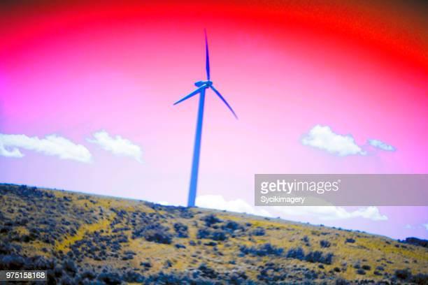 Wind turbine on hillside, saturated color