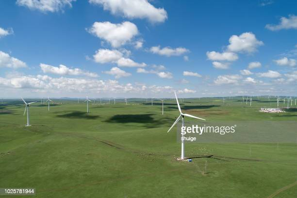 wind turbine on huitengxile grassland - corona sun stock pictures, royalty-free photos & images