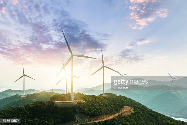 wind turbine - global warming stock pictures, royalty-free photos & images