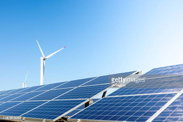 wind turbine solar panel renewable energy - east asia stock pictures, royalty-free photos & images