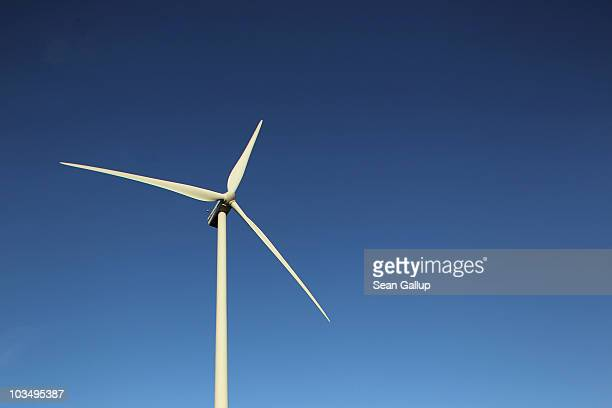 Wind turbine spins to produce electricity on August 19, 2010 near Proesitz, Germany. Germany is investing heavily in renewable energy production,...