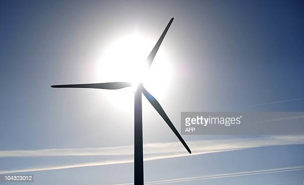 A wind turbine stands in a landscape near Husum northern Germany on September 21 2010 The Wind Energy 2010 fair is running in the northern city from...
