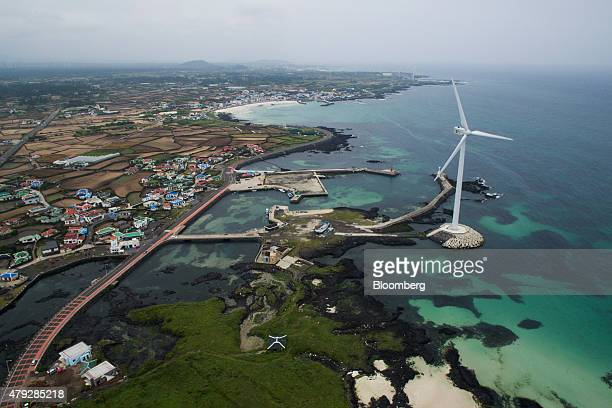 A wind turbine stands in this aerial photograph taken above the Haengwon Wind Farm in Jeju South Korea on Sunday June 28 2015 South Koreaâs 15...