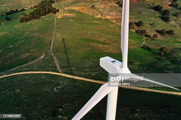 wind turbine, wind farm in green field with dirt road, renewable energy in australia - turbin bildbanksfoton och bilder
