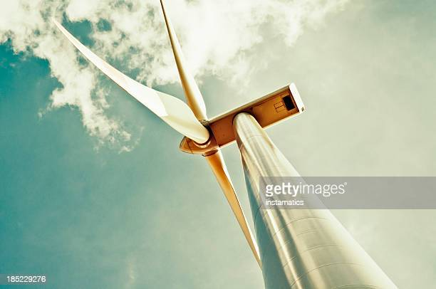 wind turbine with green sky - windenergie stockfoto's en -beelden