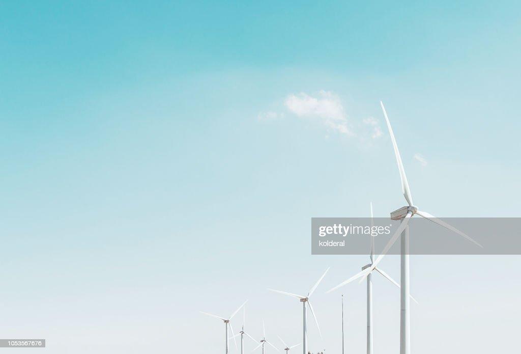 Wind turbines against blue sky : Stock Photo