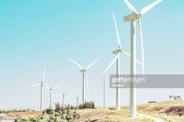 wind turbines against blue sky - power supply stock pictures, royalty-free photos & images