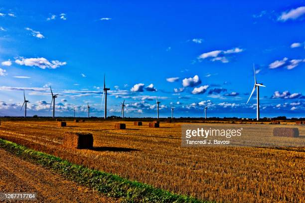 wind turbines against rural background - bavosi stock pictures, royalty-free photos & images