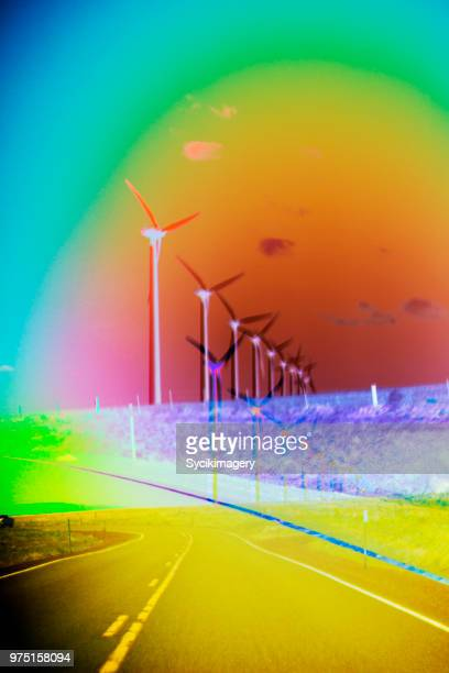 Wind turbines along rural highway, layered effect