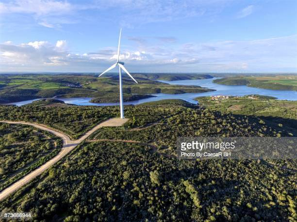 wind turbines. an aerial road trip. - zamora stock pictures, royalty-free photos & images