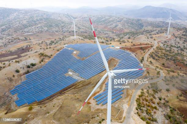 wind turbines and solar panel farm - middle east stock pictures, royalty-free photos & images