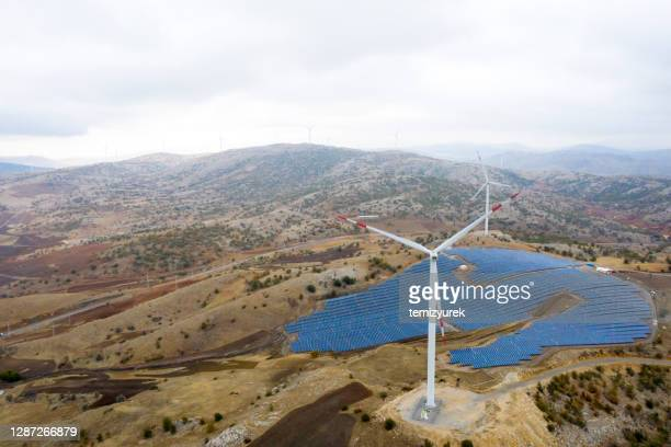wind turbines and solar panel farm - wind stock pictures, royalty-free photos & images