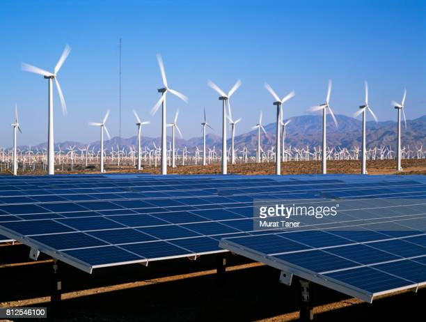 wind turbines and solar panels - renewable energy stock pictures, royalty-free photos & images
