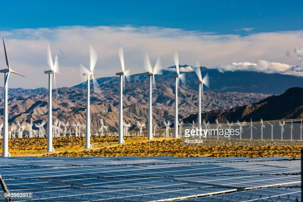 wind turbines and solar panels - solar powered station stock pictures, royalty-free photos & images