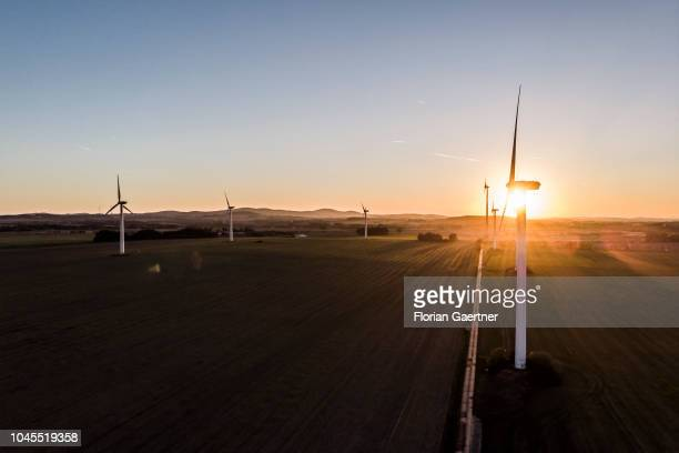 Wind turbines are pictured during sunset on September 30 2018 in Melaune Germany