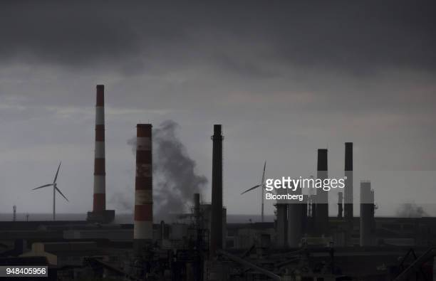 Wind turbines are seen beyond the Nippon Steel Sumitomo Metal Corp plant in Kashima Ibaraki Japan on Wednesday April 18 2018 President Donald...
