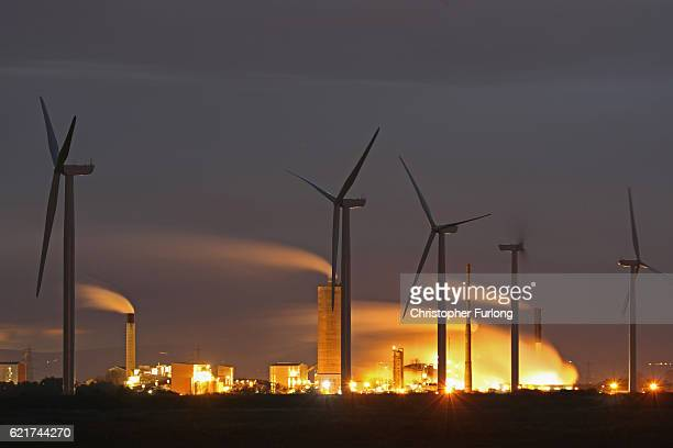 Wind Turbines are seen on Ince Salt Marshes near to chemical and manufacturing plants on the River Mersey estuary on November 7 2016 in Runcorn...