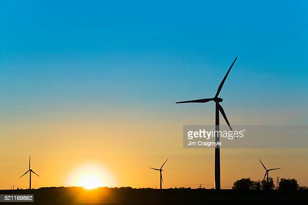 wind turbines at sunrise - jim craigmyle stock pictures, royalty-free photos & images