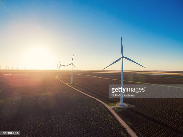 wind turbines at sunrise - windmills stock photos and pictures
