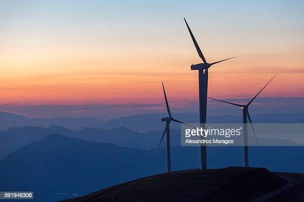 wind turbines at sunset - peninsula de grecia fotografías e imágenes de stock