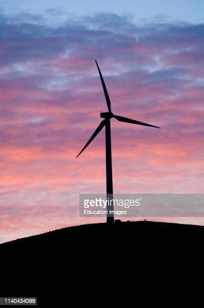 Wind turbines at sunset Shetland Scotland