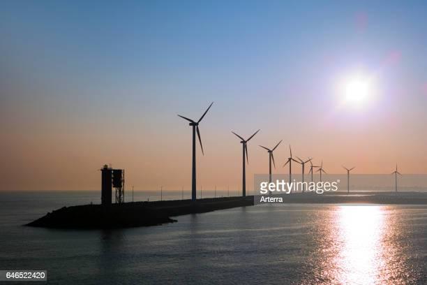Wind turbines at windfarm on dam in the Zeebrugge / Zeebruges seaport Belgium