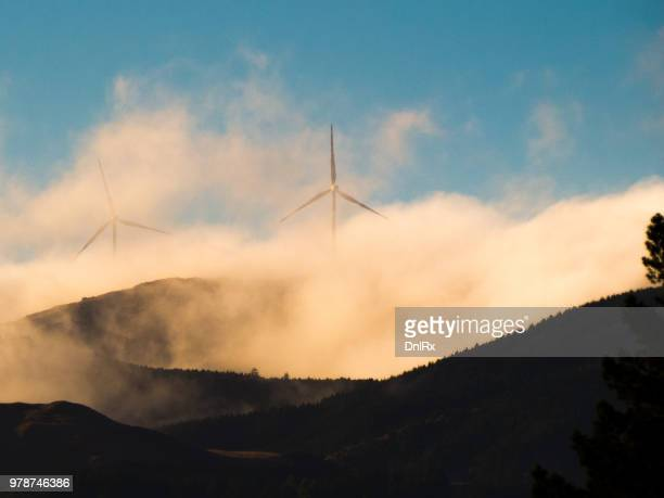 wind turbines behind clouds, palmerston north, manawatu-wanganui, new zealand - palmerston north new zealand stock pictures, royalty-free photos & images