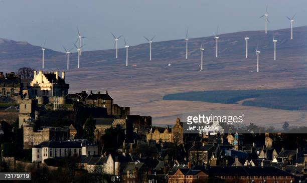 Wind Turbines dominate the hillside behind Stirling Castle February 2 2007 in Stirling Scotland Reports by The Intergovernmental Panel on Climate...