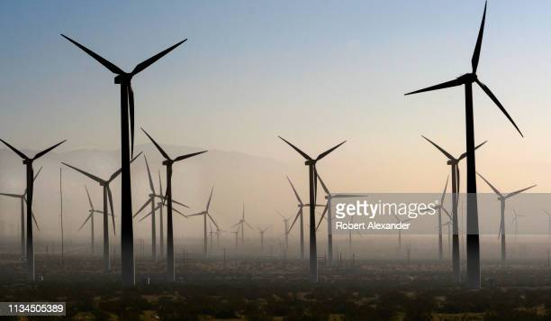 Wind turbines generate electricity at the San Gorgonio Pass Wind Farm near Palm Springs California as a dust storm blows through the area Located in...