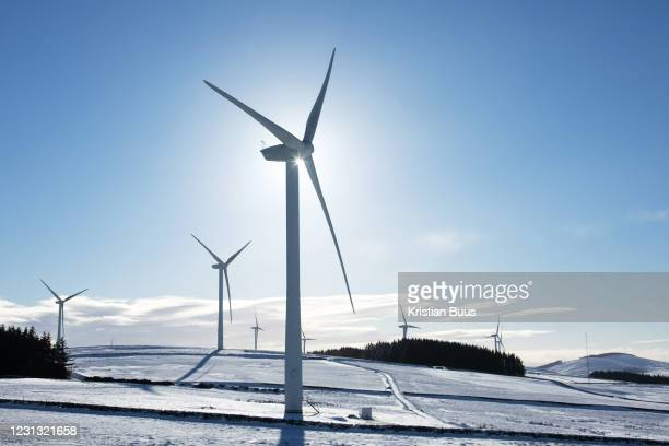 Wind turbines harnessing the wind in the Scottish Borders on 25th of January 2021 in Scotland, United Kingdom. The wind farm, Longpark Wind Farm, is...