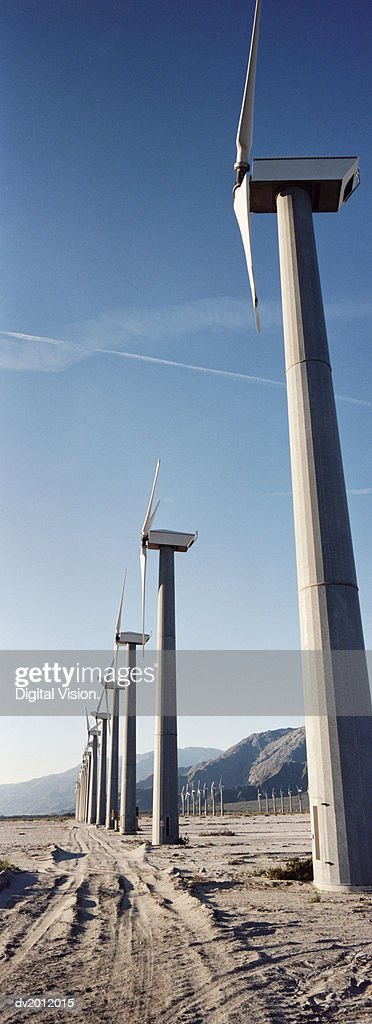 Wind Turbines in a Row in an Arid Landscape : Stock Photo
