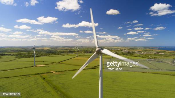 wind turbines in countryside - wind stock pictures, royalty-free photos & images