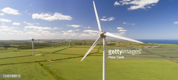 wind turbines in countryside - sustainable resources stock pictures, royalty-free photos & images