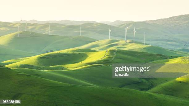wind turbines in rolling landscape, brushy peak, california, america, usa - sustainability stock photos and pictures