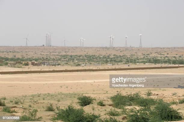 wind turbines in sandy expanse of thar desert (great indian desert) as seen from jaisalmer fort, rajasthan, india - great sandy desert fotografías e imágenes de stock