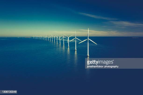 wind turbines in the ocean - capital cities stock pictures, royalty-free photos & images
