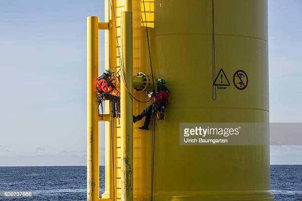 Wind turbines in the offshore wind farm Amrumbank West of the EON SE Technicians during maintenance work on a wind turbine